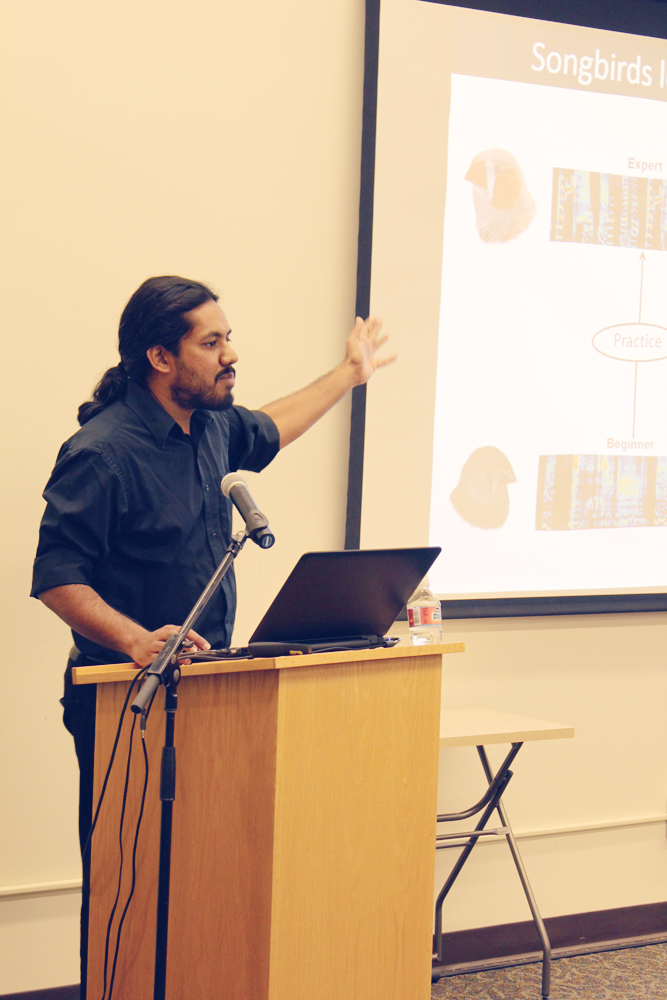 At the inaugural SPARK Talks event Thursday, Vikram Gadagkar discusses the clues given by songbirds in the environment. (Rula Saeed / Sun Staff Photographer)
