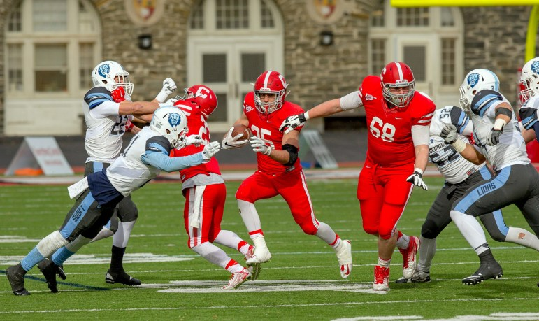 Senior running back Luke Hagy ran for 68 yards on 24 carries en route to the Red's 3-0 victory over Columbia. (Courtesy of Dave Burbank)