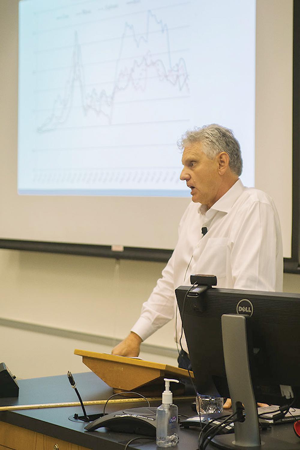 Prof. Harry de Gorter talks about the reason for rising corn prices at a book talk at Mann Library Thursday.  (Cameron Pollack / Sun Senior Photographer)