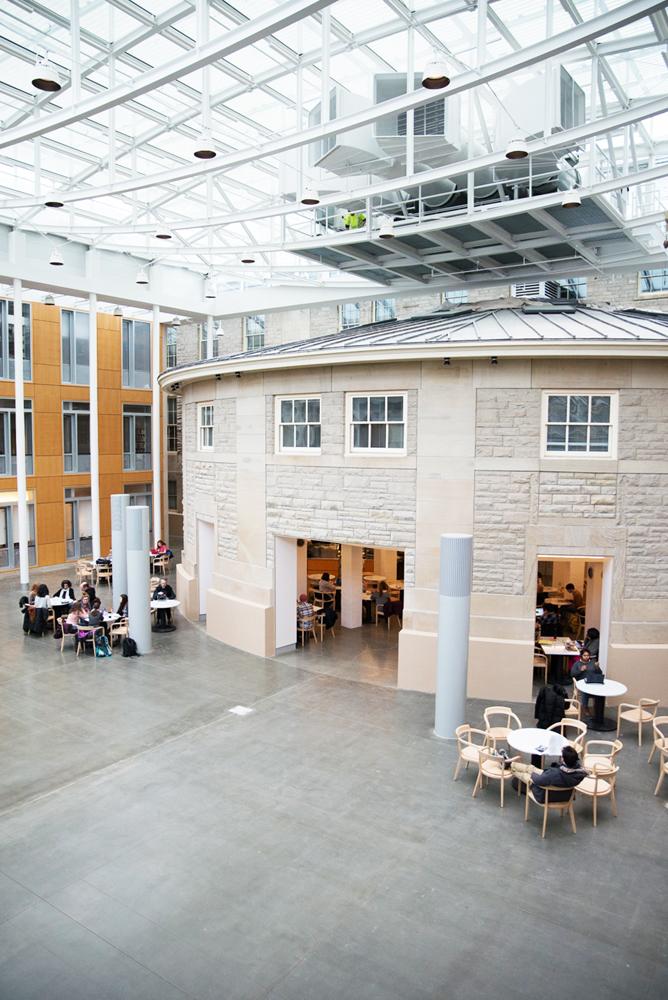 Klarman Hall adjoins Goldwin Smith Hall, with its atrium containing the older humanities building's rotunda.