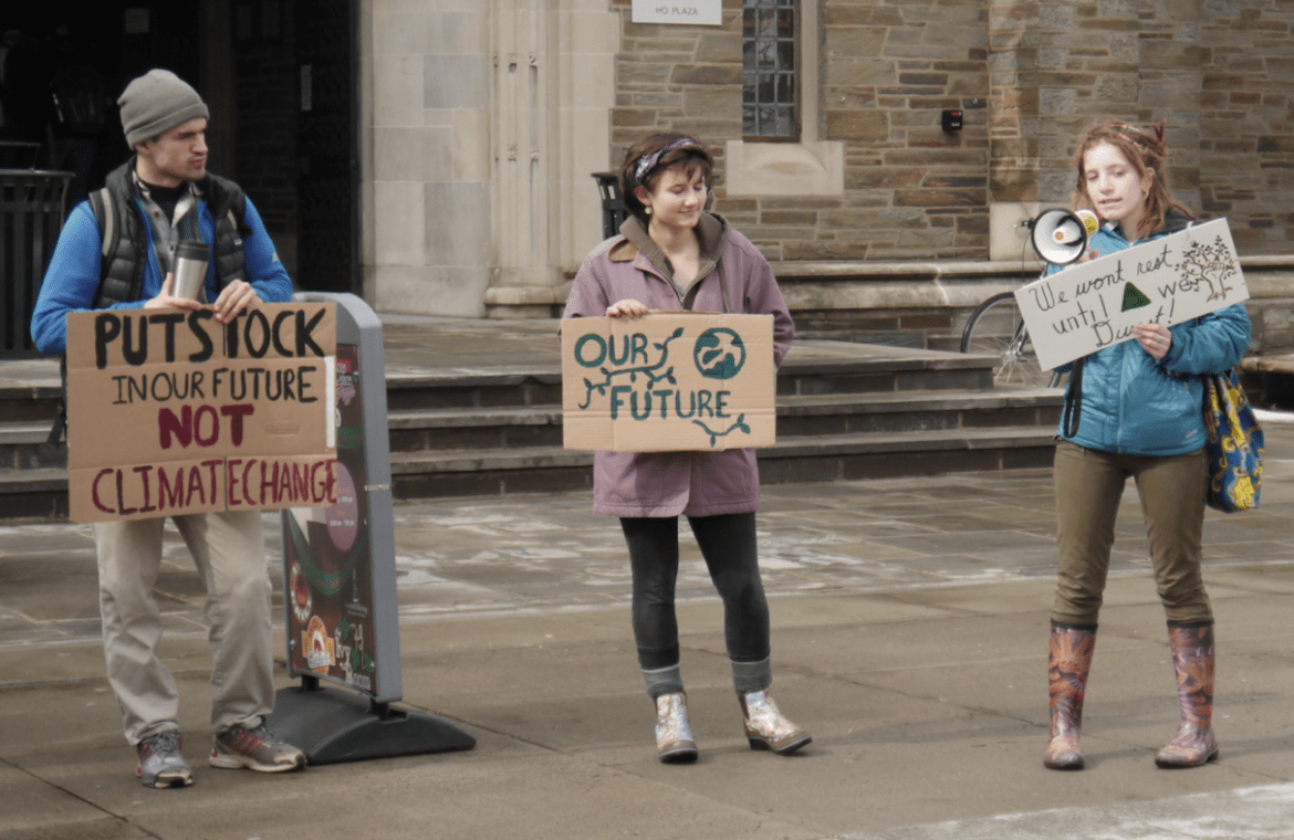 Students campaign for Cornell's divestment from fossil fuels outside Willard Straight Hall.