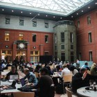 Faculty and students utlize Sage Atrium Monday in Sage Hall, home of the Johnson Graduate School of Management