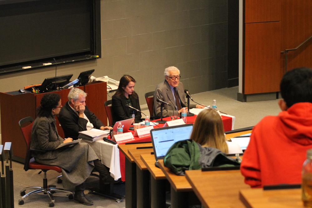 Three policy experts discuss the Syrian refugee Crisis at a talk Tuesday.
