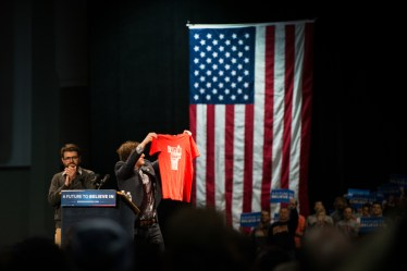 Zach Silver shows the crowd a shirt from his 2006 campaign to get Bernie Sanders elected to the senate.