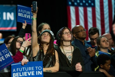 Supporters await the arrival of Sanders at a rally Tuesday.