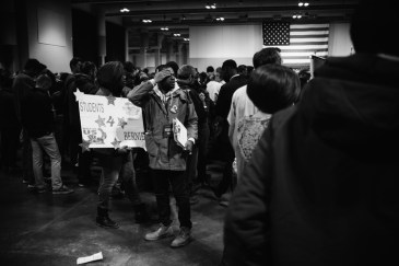 "Young people carry ""Students for Bernie"" posters in Oncenter."