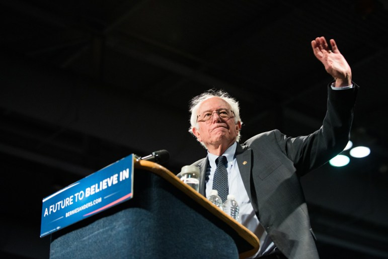 Presidential candidate Bernie Sanders waves at the crowd in Syracuse Tuesday.