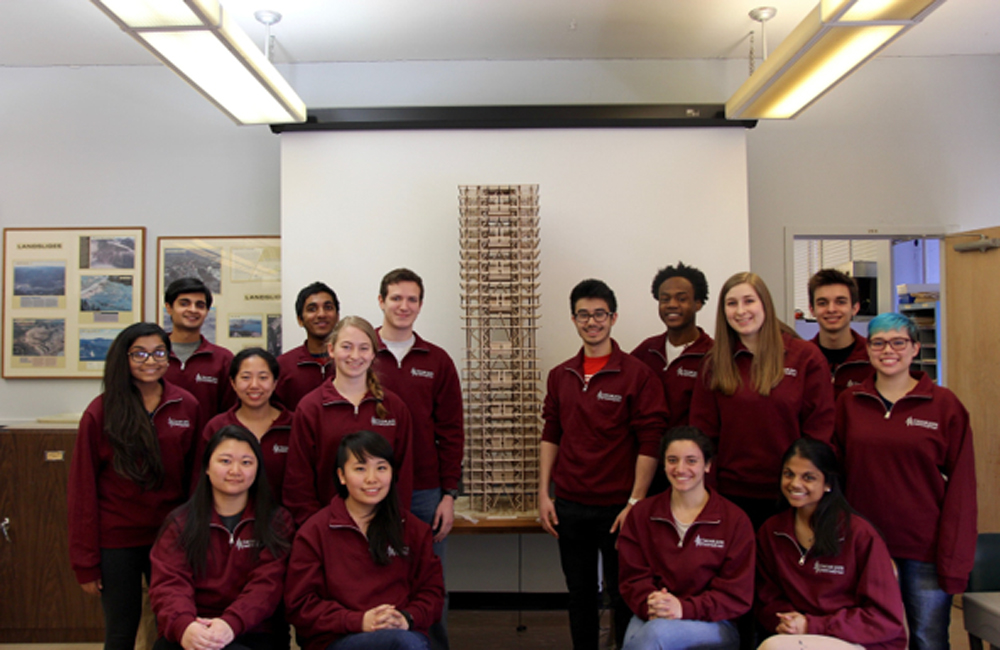 Cornell University Seismic Design Team standing with their building prototype