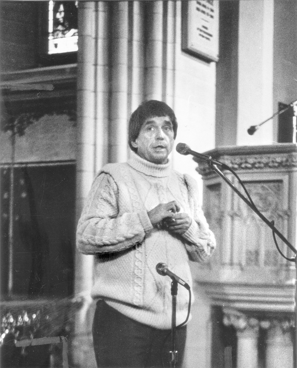 America Is Hard to Find | Rev. Daniel Berrigan speaks before about 1,000 people in Sage Chapel on January 26, 1975 to give the first sermon of that spring semester. It was Berrigan's first public ­appearance on the Cornell campus since April 1970 when he stunned a throng of 15,000 by appearing at a Barton Hall celebration in his honor, even though he was then a fugitive being actively hunted by the FBI.