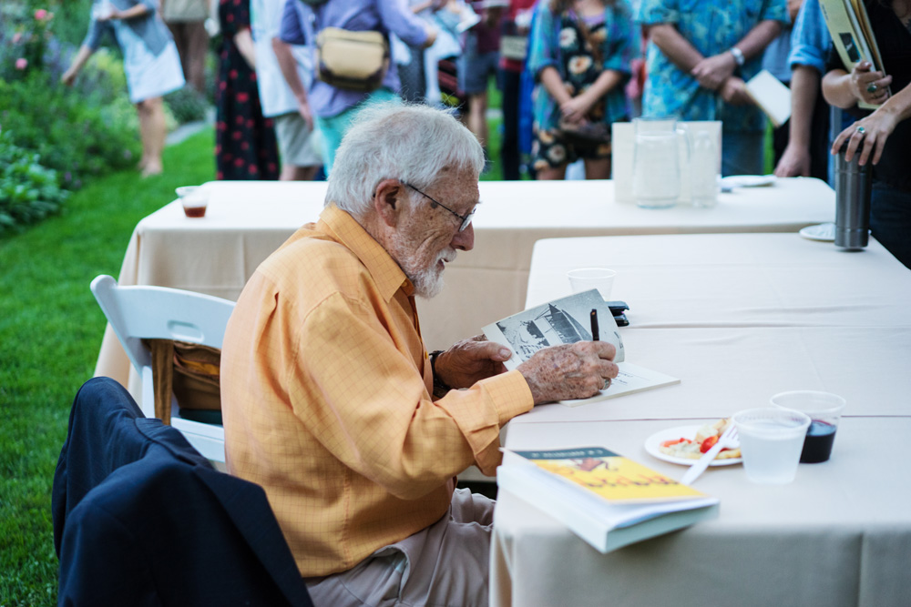 Celebrated poet Gary Snyder signs autographs and talks to fans following his lecture at Kennedy Hall auditorium on Wednesday.