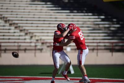 Senior captains Ben Rogers celebrates with his classmate Nick Bland after a 43-yard touchdown.