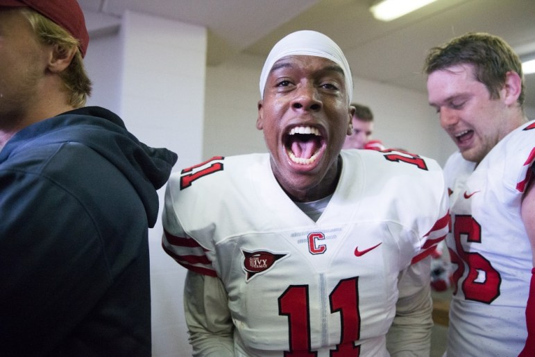 Demetrius Daltrius screams in the locker room after knocking off Colgate.