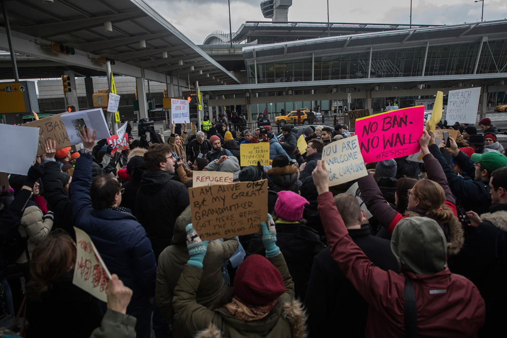 Protests erupt on Jan. 28 outside New York's JFK Airport following the detainment of several immigrants.