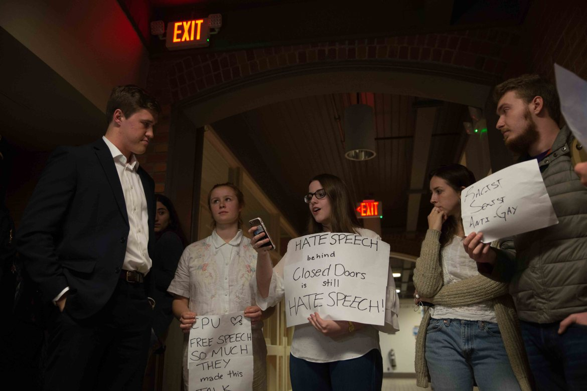 Protests at Michael Johns' speech in Rockefeller Hall on Tuesday evening. (Cameron Pollack / Sun Photography Editor)