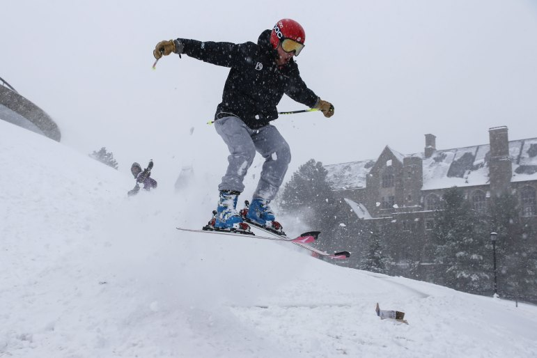 Catching some air, a student glides down Libe Slope during the snow day celebrations on Tuesday.