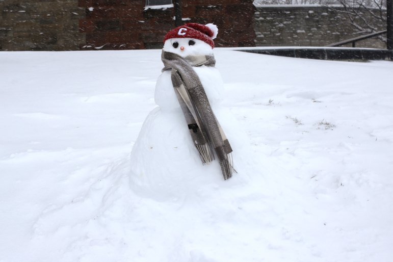 A snowman with Big Red spirit next to Uris Hall at Cornell on Tuesday.