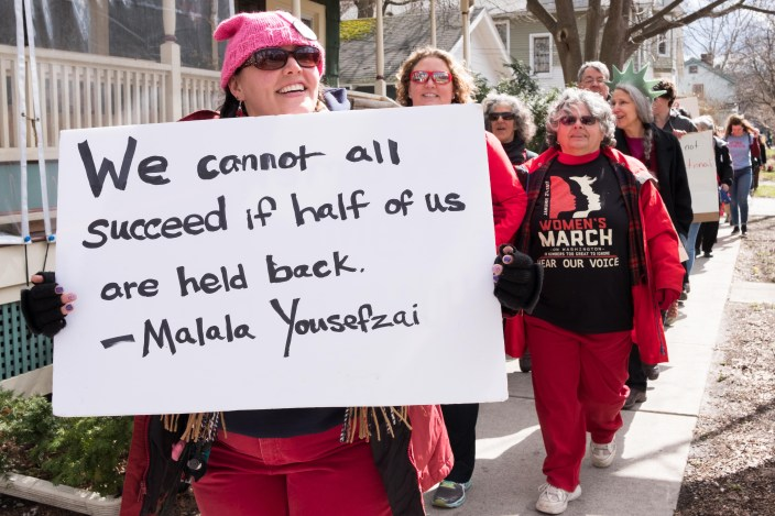 Demonstrators at the Ithaca Women's Day March on Wednesday that began at Ithaca City Hall. (Michael Suguitan / Sun Staff Photographer).