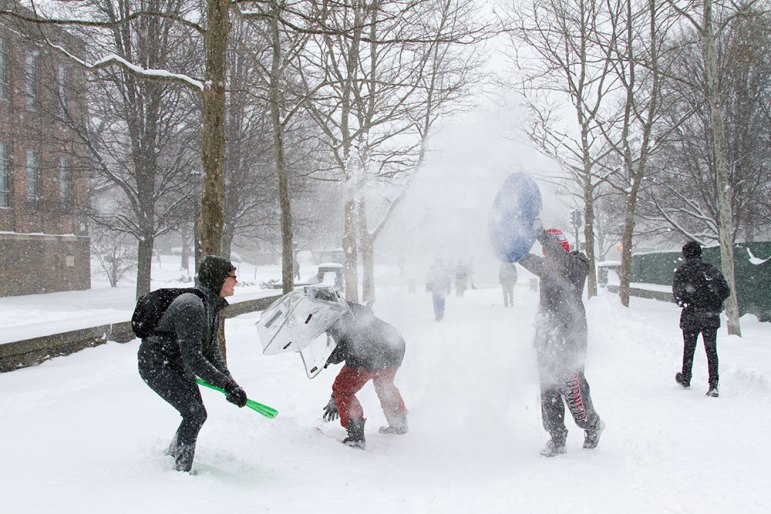 Snowball fights broke out across campus on Tuesday as some students used sleds for shields.