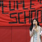 An organizer speaks at the People's School's second meeting Saturday at Beverly J. Martin Elementary School.