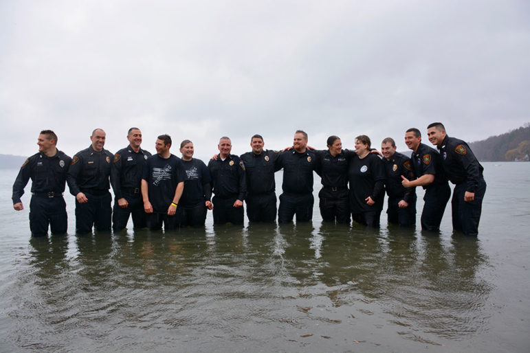 Members of the Ithaca Police Department stand for a group photo on Saturday moments before being splashed.