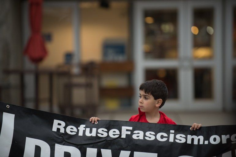 Abi Shamoun, a Syrian-American 6-year-old, accompanied his mother to a protest against the U.S. missile strike in Syria. It was about his 10th protest, his mother said.
