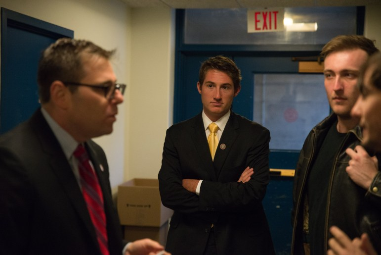 Mitch McBride '17 stands with his lawyer, Alan Sash, left, in Day Hall, where the University Hearing Board cleared him of both charges on Wednesday.