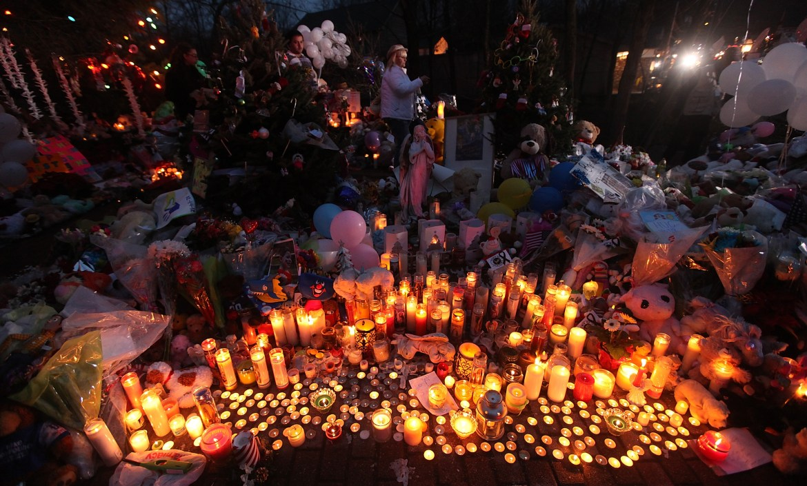 NEWTOWN, CT - DECEMBER 17, 2012:  Candles are lit among mementos at a memorial for victims of the mass shooting at Sandy Hook Elementary School, on December 17, 2012 in Newtown, Connecticut.