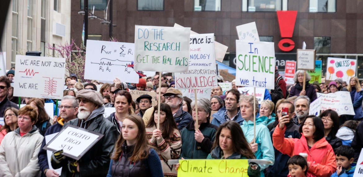 Demonstrators listen to a keynote speaker at Ithaca's March for Science.