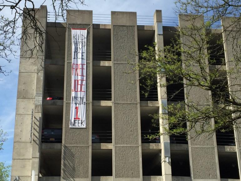 A banner on the Seneca Street parking garage on Tuesday, protesting the arrest of José Guzman-Lopez