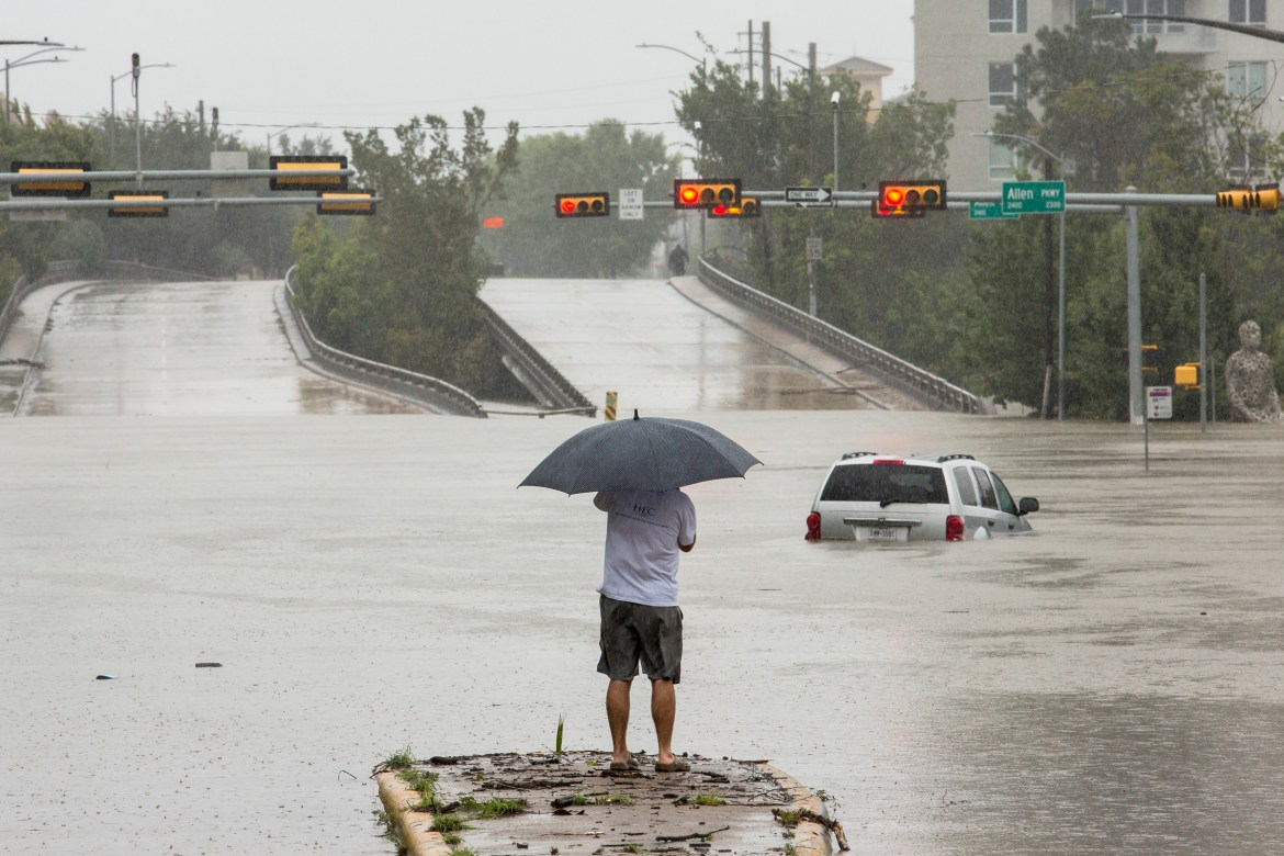 A car is caught in the flooding in Houston Monday.