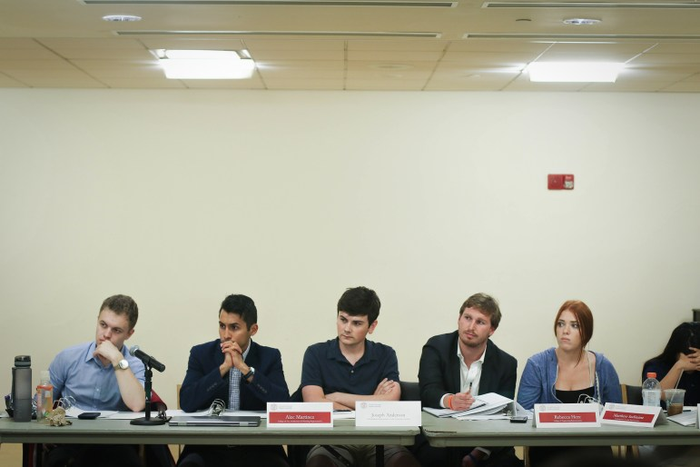 From left, Christopher Schott, Alec Martinez, Joseph Anderson, Matt Indimine, and Rebecca Herz listen to deliberations at the Student Assembly meeting in RPCC on September 7th, 2017 (Michael Wenye Li / Sun Assistant Photography Editor)