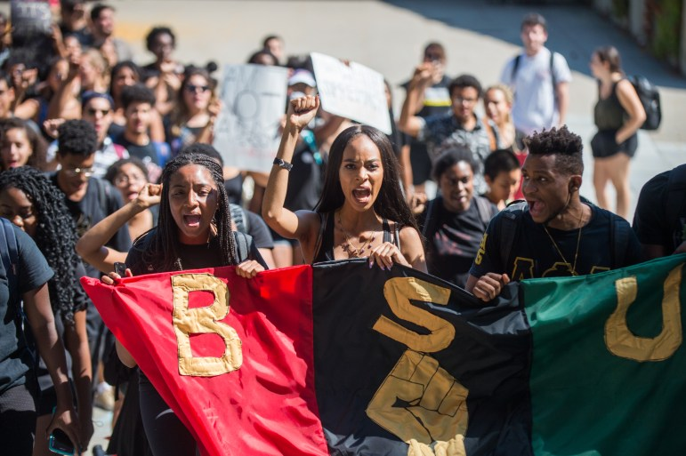BSU and allies march from Day Hall to Willard Straight Hall, September 20th, 2017. (Cameron Pollack / Sun Photography Editor)