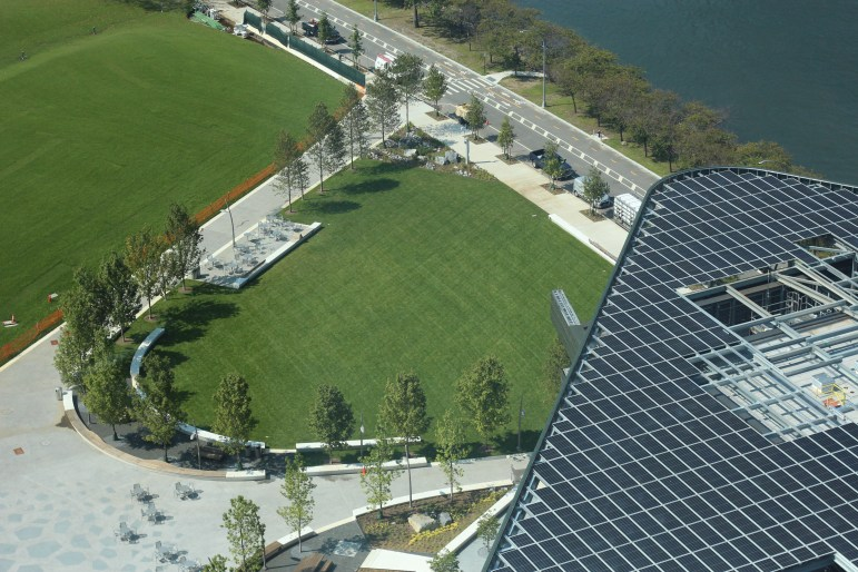 The Bloomberg Center and The Bridge building are covered with photovoltaic arrays, and the lawn covers about 80 geothermal wells.