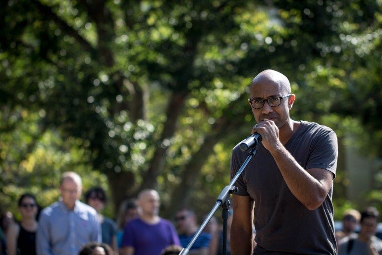 Prof. Russell Rickford, history, spoke to hundreds on the Arts Quad who gathered to protest racism nationally and locally.