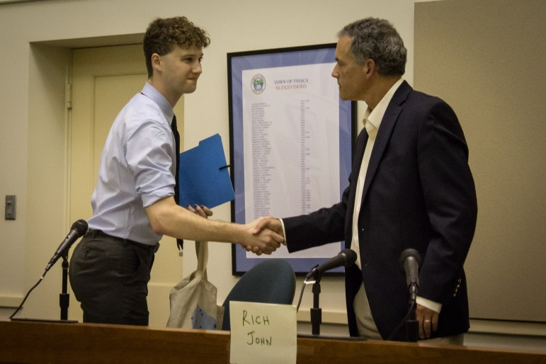 Reed Steberger '13, left, and Rich John '81 shake hands on Thursday after Steberger withdrew from the race, leaving John, the incumbent, to run uncontested for the District Four seat.