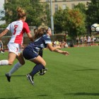 Sophomore Abby Adams battles for a ball during a women's soccer match against Maine Saturday.
