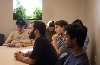 Students and faculty listen intently to Alidou at her seminar.