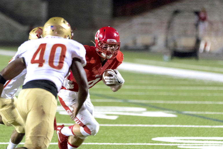 Cornell wins 48-20 on Friday vs. Caldwell University. Above, Will Griffen rushes for a touchdown. (Jason Ben Nathan / Sun Senior Photographer)