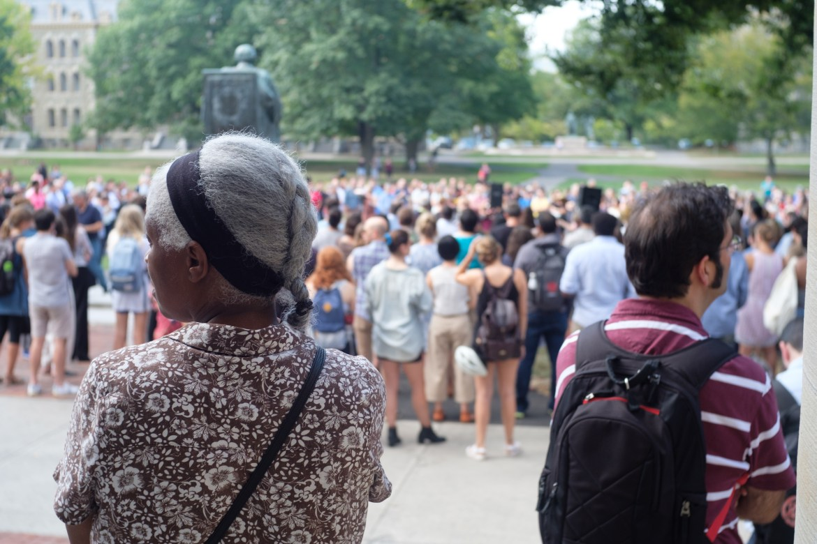 Cornellians look over the Arts Quad from Goldwin Smith Hall at Cornell on Wednesday, Sept. 27, 2017, during a protest against racism nationally and locally.