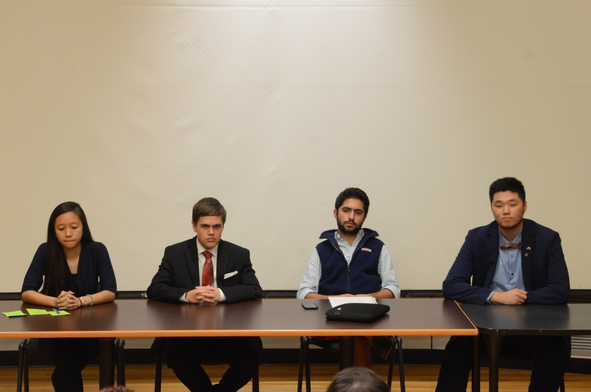 Freshmen candidates for Student Assembly field questions from members of the Cornell Speech and Debate Society.