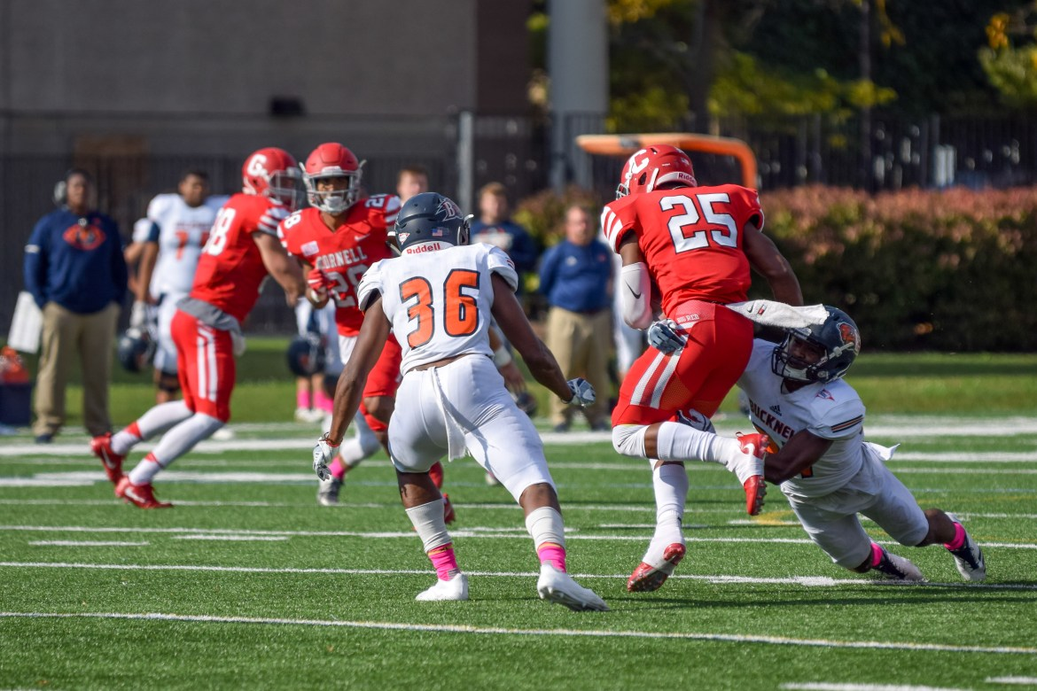 SK Howard (right, #25) attempts a rush in football's 26-18 loss to Bucknell Saturday. The freshman had 73 rushing yards in his first instance of varsity experience.