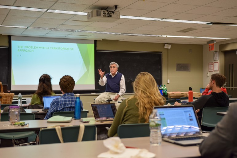 Professor Rocco Scanza, engages his class in a heated discussion on the continuing relevance of 1962.