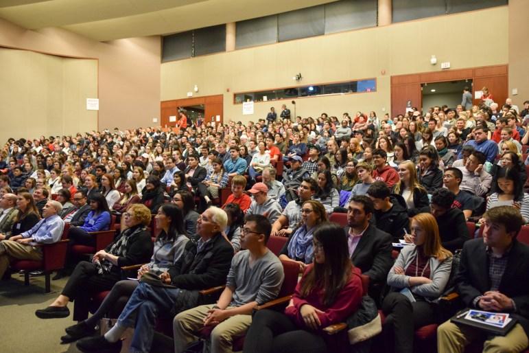 Dr. Elisabeth Rosenthal addresses a full auditorium about healthcare Monday evening.