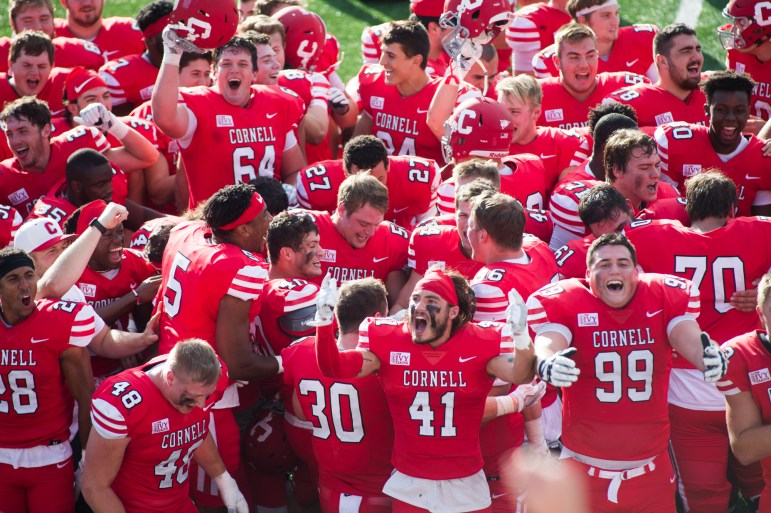 """Members of the 130th Cornell football team belt out a rendition of """"Cornell Victorious"""" for the first time of the year."""