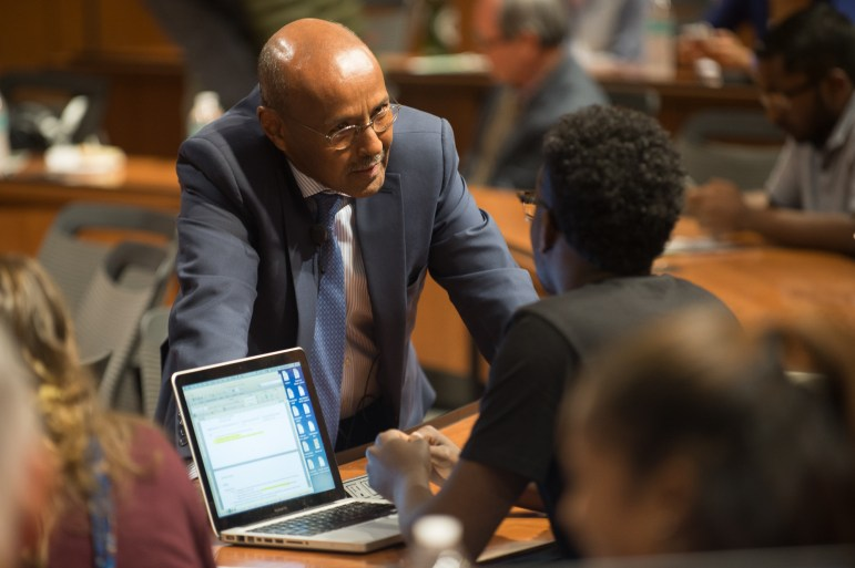 Judge Abdulqawi Yusuf, Vice-President of the International Court of Justice, speaks with third-year law student Adam Mohamed in Myron Taylor Hall, Oct. 23, 2017. (Cameron Pollack / Sun Photography Editor)