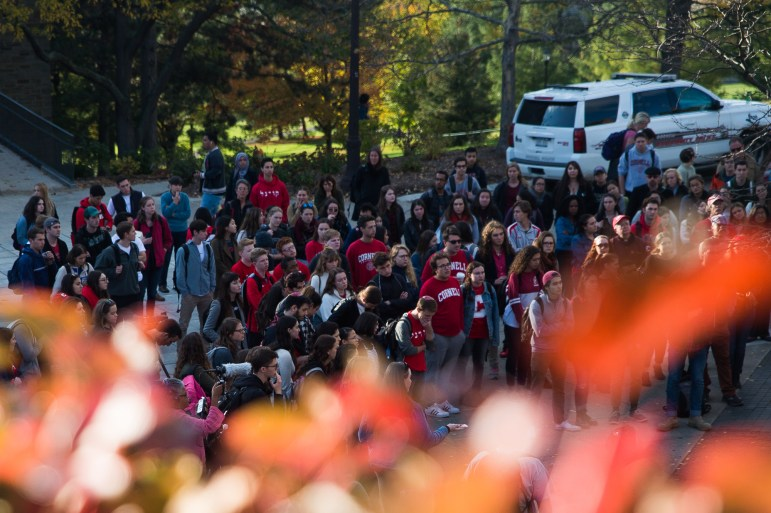 """The crowd listens to speakers at the """"Stand Together"""" rally on Ho Plaza, Oct. 23, 2017, two days after anti-semitic posters and stickers were found across campus. (Cameron Pollack / Sun Photography Editor)"""