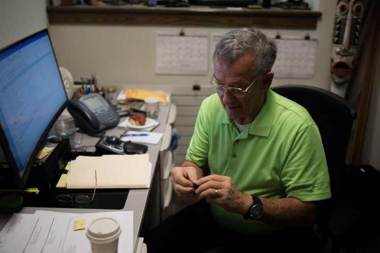 Henry W. Crans, Jr., director of facilities for the College of Arts and Sciences, inspects one of the devices in his office in Goldwin Smith Hall on Thursday.
