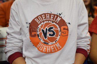 "Members of the Boeheim family wore ""Boeheim vs. Boeheim"" shirts to support both Jimmy and Jim in the contest."