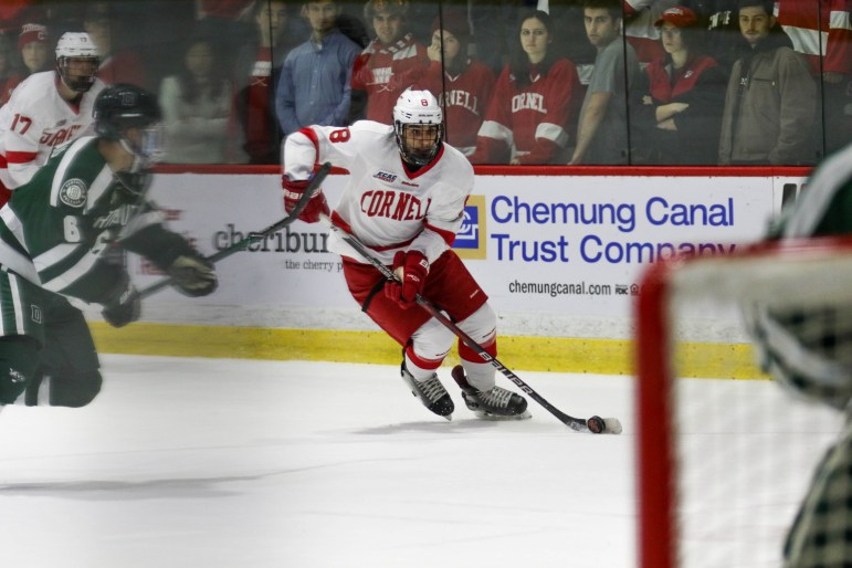 Cornell secured its first home win over Dartmouth since 2012 Friday night at Lynah. Above, defenseman Yanni KaldisIce (#8) aims for the goal. (Michael Wenye Li/ Sun Assistant Photography Editor)