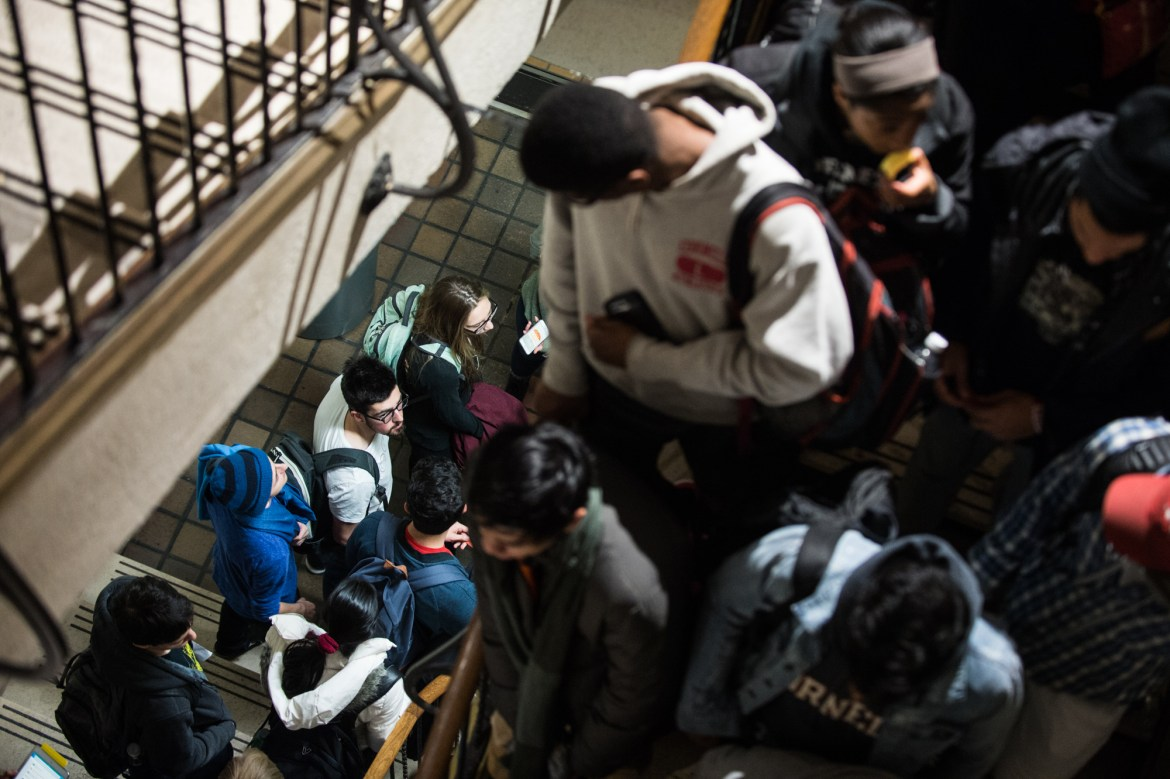 Students pack the stairwells in an attempt to get tickets to an advance screening of Justice League at Cornell Cinema in Willard Straight Hall on Nov. 14. The Cinema's funding is now in jeopardy.